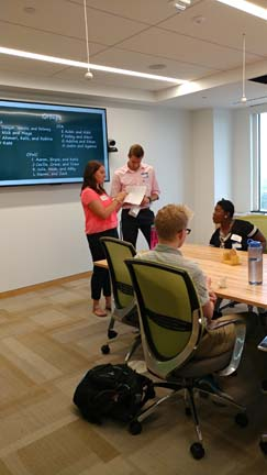 2017 Interns at the Community Foundation for the Alleghenies explain an activity at the Youth Philanthropy Summit (Photo by Amma Ababio)