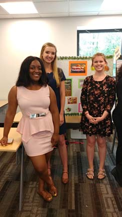 2017 SYPIP Interns Delaney Morrow Natalie Weida and Delajah Dennis present their RFP at a poster session in the Carnegie Library in Hazelwood (Photo by Amma Ababio)