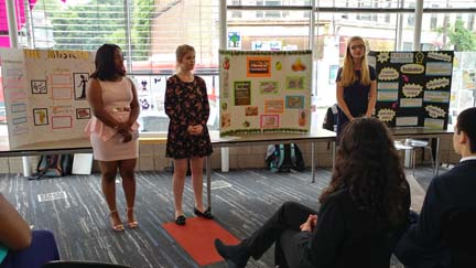2017 SYPIP Interns Delaney Morrow Natalie Weida and Delajah Dennis present their RFP at a poster session in the Carnegie Library in the Hill District (Photo by Amma Ababio)