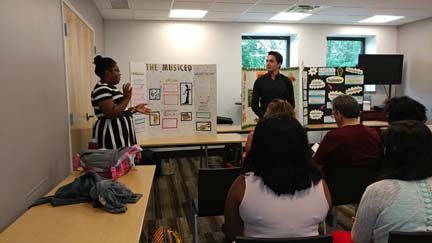 2017 SYPIP Interns Katie Davenport and Joey Scapalleto present their RFP at a poster session in the Carnegie Library in Hazelwood (Photo by Amma Ababio)