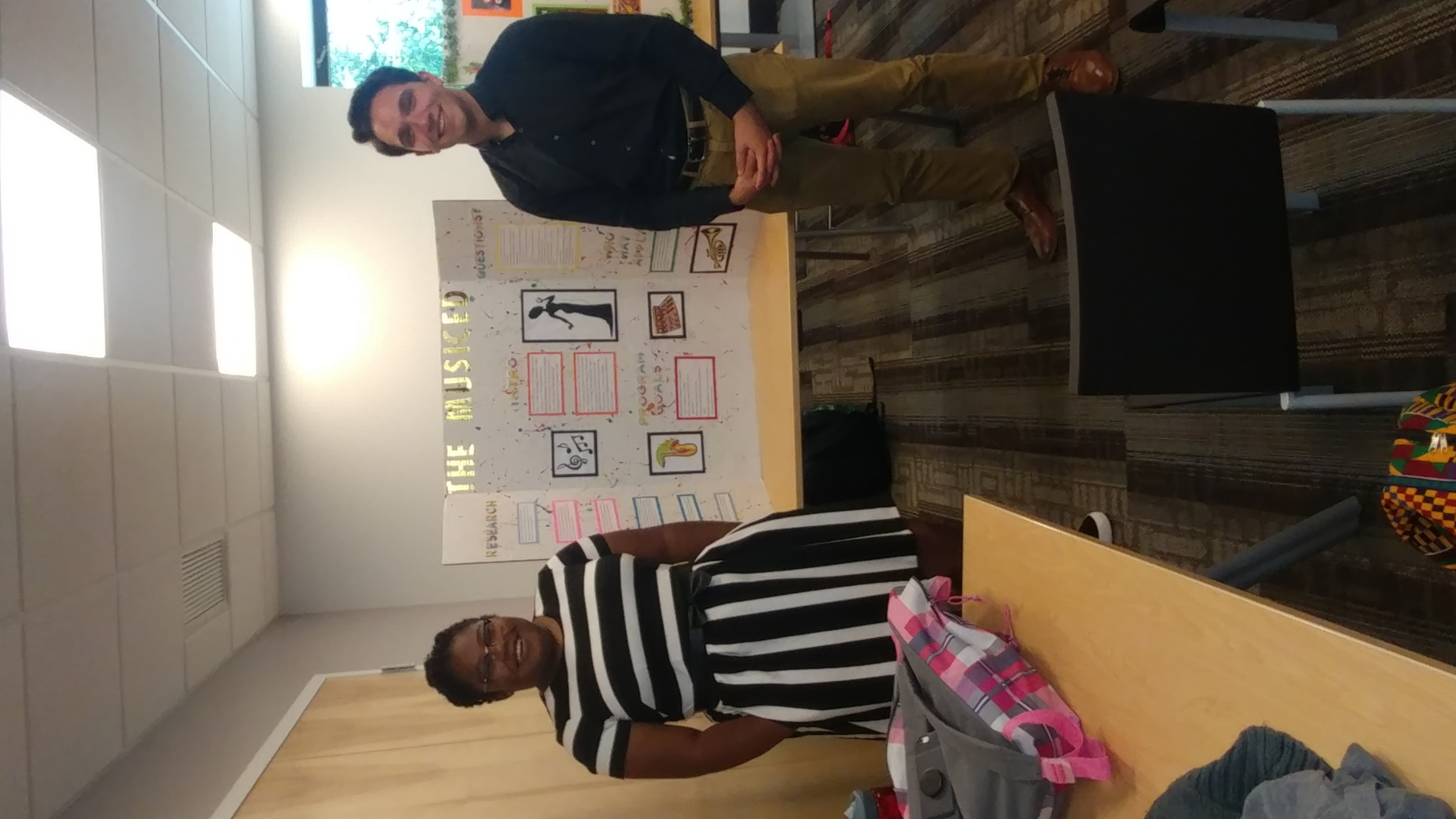2017 SYPIP Interns Katie Davenport and Joey Scapellato present their RFP at a poster session in the Carnegie Library in Hazelwood (Photo by Amma Ababio)