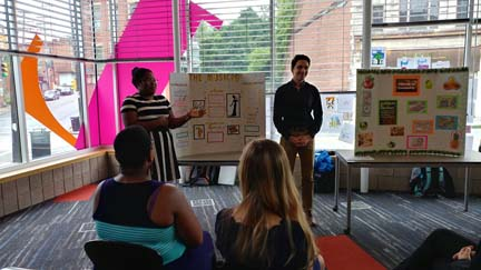 2017 SYPIP Interns Katie Davenport and Joey Scapellato present their RFP at a poster session in the Carnegie Library in the Hill District (Photo by Amma Ababio)