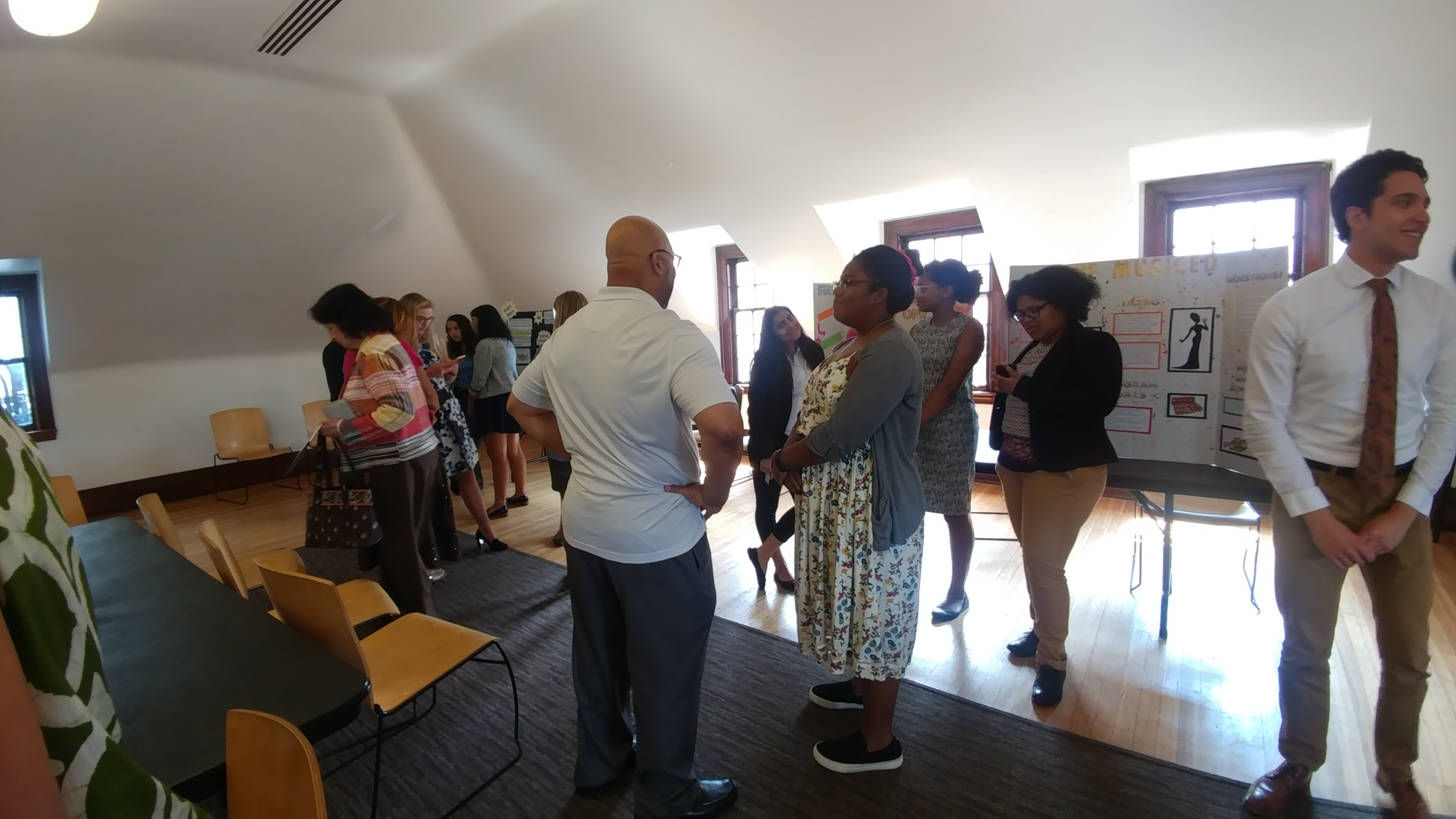 2017 SYPIP Interns speak with audience members at their RFP poster presentation at the Carnegie Library in Homewood (Photo by Amma Ababio) (4)